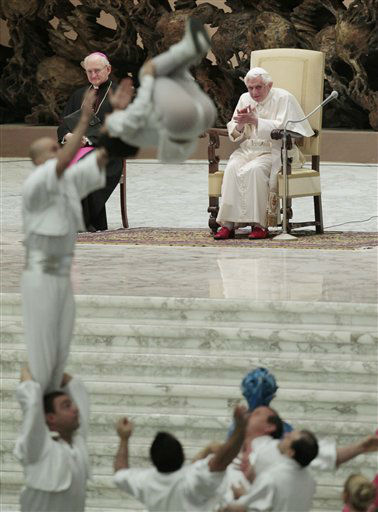 "<div class=""meta ""><span class=""caption-text "">Italian Circus acrobats perform in front of Pope Benedict XVI during his weekly general audience in the Paul VI hall at the Vatican, Wednesday, Jan. 11, 2012. (AP Photo/Gregorio Borgia) (AP Photo/ Gregorio Borgia)</span></div>"