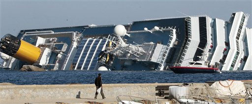 The luxury cruise ship Costa Concordia leans on its starboard side as seen from the Giglio harbor, after running aground off the tiny Tuscan island of Giglio, Italy, Saturday, Jan. 14, 2012.  The luxury cruise ship ran aground off the coast of Tuscany, sending water pouring in through a 160-foot &#40;50-meter&#41; gash in the hull and forcing the evacuation of some 4,200 people from the listing vessel early Saturday, the Italian coast guard said.  The number of dead and injured is not yet confirmed Coast Guard Cmdr. Francesco Paolillo said. &#40;AP Photo&#47;Gregorio Borgia&#41; <span class=meta>(AP Photo&#47; Gregorio Borgia)</span>