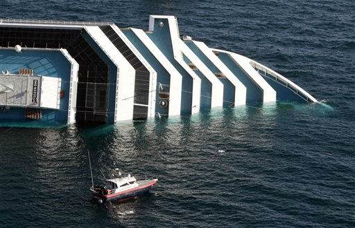 "<div class=""meta ""><span class=""caption-text "">A Carabinieri (Italian paramilitary police) boat approaches the luxury cruise ship Costa Concordia after it ran aground off the tiny Tuscan island of Giglio, Italy, Saturday, Jan. 14, 2012. The luxury cruise ship ran aground off the coast of Tuscany, sending water pouring in through a 160-foot (50-meter) gash in the hull and forcing the evacuation of some 4,200 people from the listing vessel early Saturday, the Italian coast guard said.  The number of dead and injured is not yet confirmed Coast Guard Cmdr. Francesco Paolillo said.  (AP Photo/Gregorio Borgia) (AP Photo/ Gregorio Borgia)</span></div>"