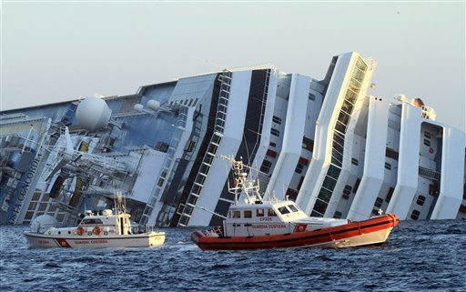 The luxury cruise ship Costa Concordia leans on its side as after running aground off the tiny Tuscan island of Giglio, Italy, Saturday, Jan. 14, 2012. The luxury cruise ship ran aground off the coast of Tuscany, sending water pouring in through a 160-foot &#40;50-meter&#41; gash in the hull and forcing the evacuation of some 4,200 people from the listing vessel early Saturday, the Italian coast guard said. &#40;AP Photo&#47;Enzo Russo&#41; <span class=meta>(AP Photo&#47; Enzo Russo)</span>