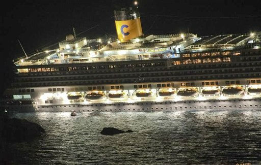 The luxury cruise ship Costa Concordia leans after it ran aground off the coast of the Isola del Giglio island, Italy, gashing open the hull and forcing some 4,200 people aboard to evacuate aboard lifeboats to the nearby Isola del Giglio island, early Saturday, Jan. 14, 2012. About 1,000 Italian passengers were onboard, as well as more than 500 Germans, about 160 French and about 1,000 crew members. &#40;AP Photo&#47;Giglionews.it, Giorgio Fanciulli&#41; <span class=meta>(AP Photo&#47; Giorgio Fanciulli)</span>