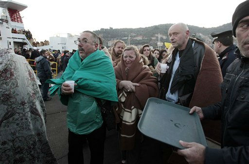 "<div class=""meta ""><span class=""caption-text "">Passengers of the luxury ship that ran aground off the coast of Tuscany arrive on a ferry in Porto Santo Stefano, Italy, Saturday, Jan. 14, 2012. A luxury cruise ship ran aground off the coast of Tuscany, gashing open the hull and taking on water, forcing some 4,200 people aboard to evacuate aboard lifeboats to a nearby island early Saturday. At least three were dead, the Italian coast guard said. Three bodies were recovered from the sea, said Coast Guard Cmdr. Francesco Paolillo. (AP Photo/Gregorio Borgia) (AP Photo/ Gregorio Borgia)</span></div>"