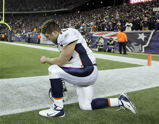 Denver Broncos quarterback Tim Tebow kneels on the sidelines before an NFL divisional playoff football game against the New England Patriots Saturday, Jan. 14, 2012, in Foxborough, Mass. &#40;AP Photo&#47;Stephan Savoia&#41; <span class=meta>(AP Photo&#47; Stephan Savoia)</span>