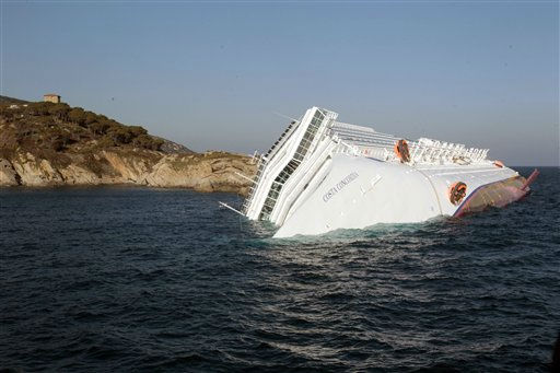 A luxury cruise ship leans on its side after running aground the tiny Tuscan island of Giglio, Italy, Saturday, Jan. 14, 2012. A luxury cruise ship ran aground off the coast of Tuscany, sending water pouring in through a 160-foot &#40;50-meter&#41; gash in the hull and forcing the evacuation of some 4,200 people from the listing vessel early Saturday, the Italian coast guard said. &#40;AP Photo&#47;Gregorio Borgia&#41; <span class=meta>(AP Photo&#47; Gregorio Borgia)</span>