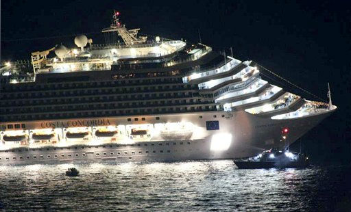 Rescuers surround the luxury cruise ship Costa Concordia after it ran aground off the coast of Isola del Giglio island, Italy, gashing open the hull and forcing some 4,200 people aboard to evacuate aboard lifeboats to the nearby Isola del Giglio island, early Saturday, Jan. 14, 2012. About 1,000 Italian passengers were onboard, as well as more than 500 Germans, about 160 French and about 1,000 crew members. &#40;AP Photo&#47;Giglionews.it, Giorgio Fanciulli&#41; <span class=meta>(AP Photo&#47; Giorgio Fanciulli)</span>
