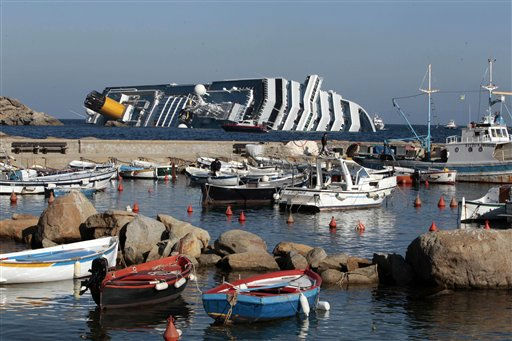The luxury cruise ship Costa Concordia leans on its side as seen from the Giglio harbor, after running aground the tiny Tuscan island of Giglio, Italy, Saturday, Jan. 14, 2012. A luxury cruise ship ran aground off the coast of Tuscany, sending water pouring in through a 160-foot &#40;50-meter&#41; gash in the hull and forcing the evacuation of some 4,200 people from the listing vessel early Saturday, the Italian coast guard said. &#40;AP Photo&#47;Gregorio Borgia&#41; <span class=meta>(AP Photo&#47; Gregorio Borgia)</span>