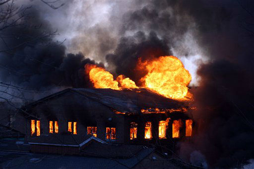 A fire burns in an old factory in Cornwall, N.Y., Sunday, Jan. 15, 2012. Authorities have not reported any injuries at the former mill about 50 miles north of New York by the Hudson River. The space is now being used to house about a dozen small businesses. &#40;AP Photo&#47;Paul Kazdan&#41; <span class=meta>(AP Photo&#47; Paul Kazdan)</span>