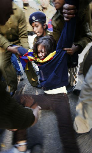 A protesting Tibetan activist is detained outside Hyderabad House where visiting Chinese delegates are meeting their Indian counterparts to talk on border issues, in New Delhi, India, Tuesday, Jan. 17, 2012. The activists protested against lack of Tibetan representation in the ongoing border talks between India and China. &#40;AP Photo&#47;Gurinder Osan&#41; <span class=meta>(AP Photo&#47; Gurinder Osan)</span>