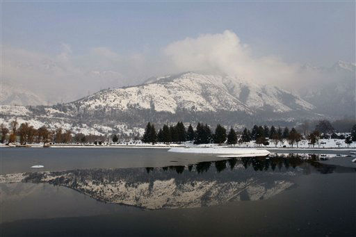 Snow-covered Zabarwan mountains are reflected in the waters of a local garden in Srinagar, India, Tuesday, Jan 17, 2012. &#40;AP Photo&#47;Mukhtar Khan&#41; <span class=meta>(AP Photo&#47; Mukhtar Khan)</span>