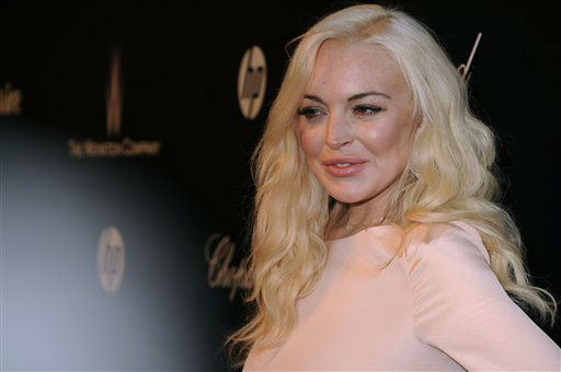 Lindsay Lohan arrives at The Weinstein Company 2012 Golden Globe After Party at the Beverly Hilton in Los Angeles. on Sunday, Jan. 15, 2012. (AP Photo/Katy Winn)