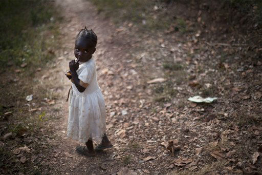 A girl walks along a road in the mountains of Calebasse, some 7 miles from Port-au-Prince, Haiti, Tuesday, Jan. 17, 2012. &#40;AP Photo&#47;Ramon Espinosa&#41; <span class=meta>(AP Photo&#47; Ramon Espinosa)</span>