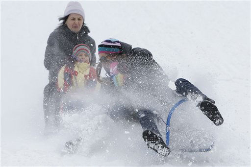 "<div class=""meta ""><span class=""caption-text "">Bosnian youth on a sledges enjoy snowy slopes at the mount Bjelasnica, near to Sarajevo, Bosnia, on Wednesday, Jan. 18, 2012.  Winter temperature and recent snowfall brought numbers of tourists from the region to the former Olympic venue to enjoy winter sports. (AP Photo/Amel Emric) (AP Photo/ Amel Emric)</span></div>"