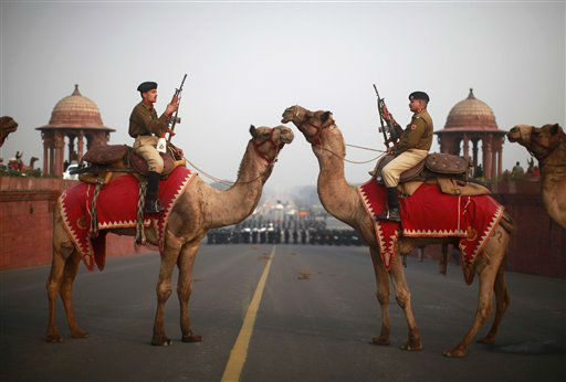 Indian Border Security Force Officers sit atop camels during preparations for the upcoming Beating Retreat ceremony on Raisina Hill near the Presidential Palace in New Delhi, India, Thursday, Jan. 19, 2012. The ceremony is held annually on January 29th. &#40;AP Photo&#47;Kevin Frayer&#41; <span class=meta>(AP Photo&#47; Kevin Frayer)</span>