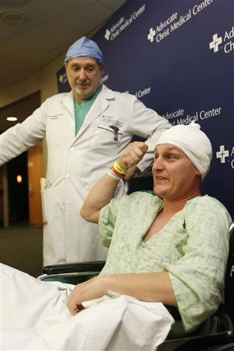 Neurosurgeon Leslie Schaffer, left, smiles as his patient Dante Autullo, shows how he injured himself during a news conference at Advocate Christ Medical Center Friday, Jan. 20, 2012, in Oak Lawn, Ill. The two spoke a day after Autullo underwent surgery to remove a 3 1&#47;4 inch nail lodged in his brain after accidentally shooting himself with a nail gun. &#40;AP Photo&#47;M. Spencer Green&#41; <span class=meta>(AP Photo&#47; M. Spencer Green)</span>