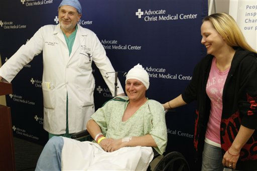 Neurosurgeon Leslie Schaffer, left, smiles with his patient Dante Autullo, and Dante&#39;s fiance, Gail Glaenzer during a news conference at Advocate Christ Medical Center Friday, Jan. 20, 2012, in Oak Lawn, Ill. The trio spoke  a day after Autullo underwent surgery to remove a 3 1&#47;4 inch nail lodged in his brain after accidentally shooting himself with a nail gun. &#40;AP Photo&#47;M. Spencer Green&#41; <span class=meta>(AP Photo&#47; M. Spencer Green)</span>