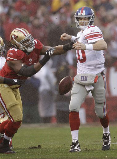 "<div class=""meta ""><span class=""caption-text "">New York Giants quarterback Eli Manning fumbles as he is hit by San Francisco 49ers' Ray McDonald (91)during the first half of the NFC Championship NFL football game Sunday, Jan. 22, 2012, in San Francisco. (AP Photo/David J. Phillip) (AP Photo/ David J. Phillip)</span></div>"