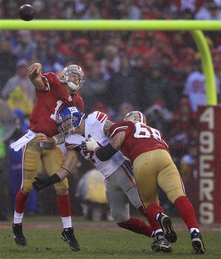 San Francisco 49ers quarterback Alex Smith &#40;11&#41; is hit by New York Giants&#39; Dave Tollefson &#40;71&#41; as he throws during the first half of the NFC Championship NFL football game Sunday, Jan. 22, 2012, in San Francisco. &#40;AP Photo&#47;Marcio Jose Sanchez&#41; <span class=meta>(AP Photo&#47; Marcio Jose Sanchez)</span>