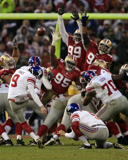 New York Giants kicker Lawrence Tynes &#40;9&#41; kicks a 31-yard field goal during the first half of the NFC Championship NFL football game against the San Francisco 49ers Sunday, Jan. 22, 2012, in San Francisco. &#40;AP Photo&#47;Marcio Jose Sanchez&#41; <span class=meta>(AP Photo&#47; Marcio Jose Sanchez)</span>