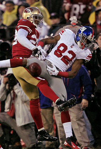 San Francisco 49ers&#39; Carlos Rogers &#40;22&#41; breaks up a pass intended for New York Giants&#39; Mario Manningham &#40;82&#41; during the first half of the NFC Championship NFL football game Sunday, Jan. 22, 2012, in San Francisco. &#40;AP Photo&#47;Marcio Jose Sanchez&#41; <span class=meta>(AP Photo&#47; Marcio Jose Sanchez)</span>