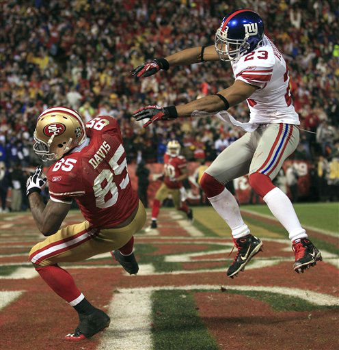 San Francisco 49ers&#39; Vernon Davis &#40;85&#41; catches a touchdown pass in front of New York Giants&#39; Corey Webster &#40;23&#41; during the second half of the NFC Championship NFL football game Sunday, Jan. 22, 2012, in San Francisco. &#40;AP Photo&#47;Marcio Jose Sanchez&#41; <span class=meta>(AP Photo&#47; Marcio Jose Sanchez)</span>