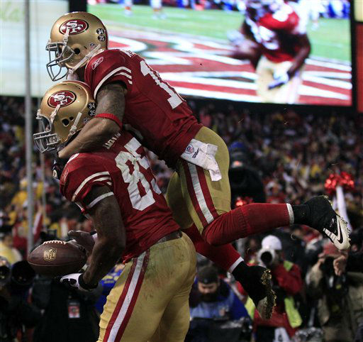San Francisco 49ers&#39; Kyle Williams jumps on the back of Vernon Davis &#40;85&#41; after Davis&#39; touchdown reception during the second half of the NFC Championship NFL football game against the New York Giants Sunday, Jan. 22, 2012, in San Francisco. &#40;AP Photo&#47;Marcio Jose Sanchez&#41; <span class=meta>(AP Photo&#47; Marcio Jose Sanchez)</span>