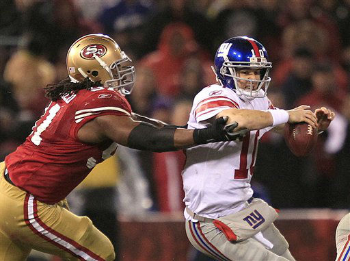 New York Giants quarterback Eli Manning is sacked by San Francisco 49ers&#39; Ray McDonald &#40;91&#41; during the second half of the NFC Championship NFL football game Sunday, Jan. 22, 2012, in San Francisco. &#40;AP Photo&#47;Marcio Jose Sanchez&#41; <span class=meta>(AP Photo&#47; Marcio Jose Sanchez)</span>