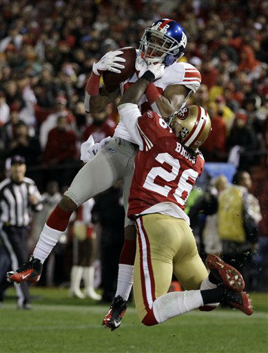 New York Giants&#39; Mario Manningham catches a touchdown pass in front of San Francisco 49ers&#39; Tramaine Brock &#40;26&#41; during the second half of the NFC Championship NFL football game Sunday, Jan. 22, 2012, in San Francisco. &#40;AP Photo&#47;Paul Sakuma&#41; <span class=meta>(AP Photo&#47; Paul Sakuma)</span>