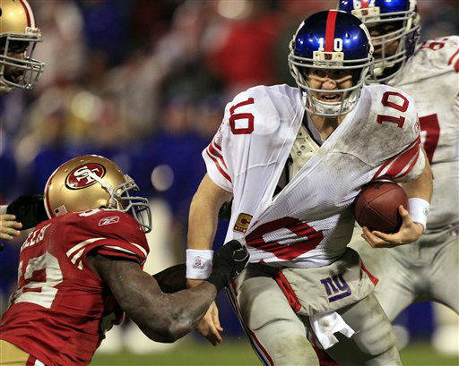 New York Giants quarterback Eli Manning is sacked by San Francisco 49ers&#39; Patrick Willis during the second half of the NFC Championship NFL football game Sunday, Jan. 22, 2012, in San Francisco. &#40;AP Photo&#47;Marcio Jose Sanchez&#41; <span class=meta>(AP Photo&#47; Marcio Jose Sanchez)</span>