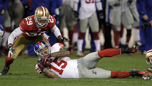 San Francisco 49ers&#39; Chris Culliver &#40;29&#41; watches as New York Giants&#39; Devin Thomas &#40;15&#41; recovers a fumbled punt by Kyle Williams during overtime of the NFC Championship NFL football game Sunday, Jan. 22, 2012, in San Francisco. &#40;AP Photo&#47;Julie Jacobson&#41; <span class=meta>(AP Photo&#47; Julie Jacobson)</span>