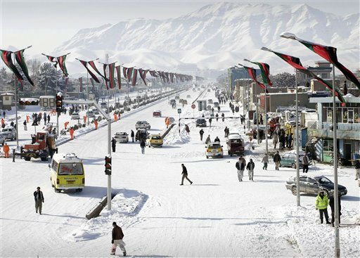 Afghans walk down a snow covered road after a snowstorm in Kabul, Afghanistan, Monday, Jan. 23, 2012. &#40;AP Photo&#47;Musadeq Sadeq&#41; <span class=meta>(AP Photo&#47; Musadeq Sadeq)</span>