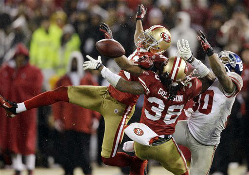 San Francisco 49ers&#39; Carlos Rogers &#40;22&#41; and Dashon Goldson &#40;38&#41; break up a pass intended for New York Giants&#39; Victor Cruz &#40;80&#41; during overtime of the NFC Championship NFL football game Sunday, Jan. 22, 2012, in San Francisco. &#40;AP Photo&#47;David J. Phillip&#41; <span class=meta>(AP Photo&#47; David J. Phillip)</span>