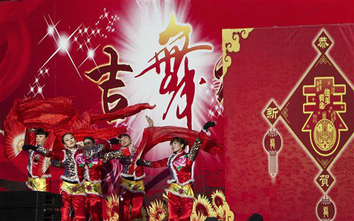 Chinese dancers perform on a stage at a temple fair in Ditan Park during the first day of the Chinese Lunar New Year in Beijing, China, Monday, Jan. 23, 2012. &#40;AP Photo&#47;Andy Wong&#41; <span class=meta>(AP Photo&#47; Andy Wong)</span>