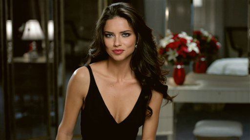 This advertisement provided by Teleflora, shows a scene from the ad with super-model Adriana Lima set to launch during Super Bowl XLVI, which will air Sunday, Feb. 5, 2012. Teleflora?s 30-second spot will debut during the game?s second quarter. About 20 of the roughly 36 Super Bowl advertisers put their TV commercials online in the days leading up to Sunday&#39;s broadcast. That&#39;s a big break with tradition and up from last year when only a handful of companies released their ads before the game. Millions have already viewed Lima&#39;s pre-released Teleflora ad. &#40;AP Photo&#47;Telaflora&#41; <span class=meta>(AP Photo&#47; Anonymous)</span>