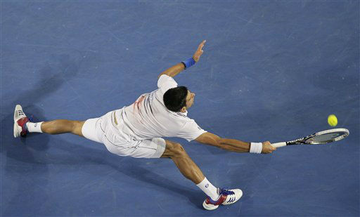 Novak Djokovic of Serbia stretches out for a return to David Ferrer of Spain during their quarterfinal at the Australian Open tennis championship, in Melbourne, Australia, Wednesday, Jan. 25, 2012. &#40;AP Photo&#47;John Donegan&#41; <span class=meta>(AP Photo&#47; John Donegan)</span>