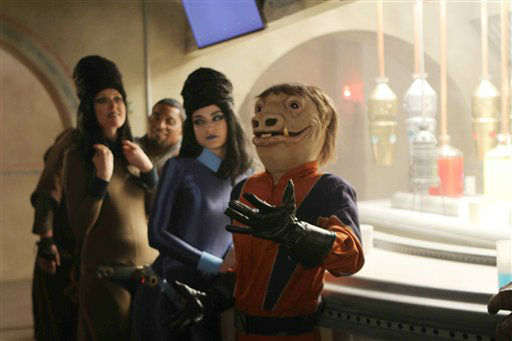 This advertisement provided by Volkswagen of America Inc., that shows a creature and friends at the bar of the Cantina, is scheduled to air during Super Bowl XLVI, Sunday, Feb. 5, 2012.  Volkswagen charmed millions of viewers last year with a ?Star Wars? themed ad introducing its redesigned 2012 Passat sedan that showed a little boy in a Darth Vader costume trying to use ?The Force? on different objects. &#40;AP Photo&#47;Volkswagen of America Inc.&#41; <span class=meta>(AP Photo&#47; Anonymous)</span>