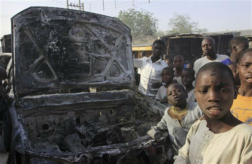 CORRECTS SPELLING OF NEIGHBORHOOD TO SHEKA    Children gather around a burntout police truck following an overnight attack at Sheka Police station in Kano, Nigeria, on Wednesday, Jan. 25, 2012. Suspected members of a radical Islamist sect attacked a police station overnight in the north Nigeria city where its previous coordinated assault killed at least 185 people. Youths on Wednesday morning overran the police station in the Sheka neighborhood of Kano, a city of more than 9 million people.  &#40;AP Photo&#47;Sunday Alamba&#41; <span class=meta>(AP Photo&#47; Sunday Alamba)</span>