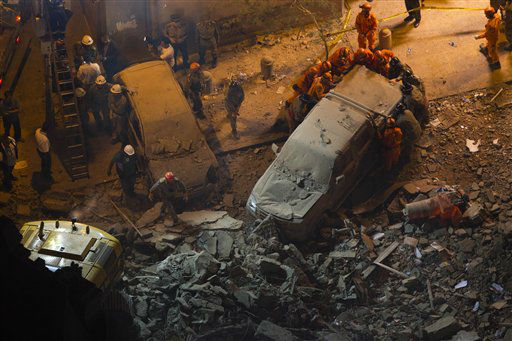 Rescue worker remove a car after a building collapsed in Rio de Janeiro, Brazil, Wednesday Jan.  25, 2012. There is no official word on deaths, but Globo television cites unidentified Brazilian authorities as saying two bodies have been found so far. &#40;AP Photo&#47;Felipe Dana&#41; <span class=meta>(AP Photo&#47; Felipe Dana)</span>