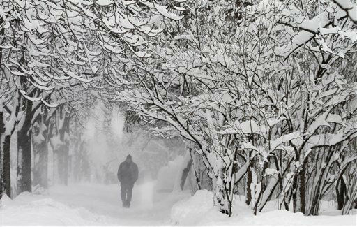 A man walks during heavy snowfall in downtown Sofia, on Thursday, Jan. 26, 2012. For two days blizzards have hit the Balkans and parts of eastern and central Europe with as much as three meters &#40;10 feet&#41; of snow at a time.&#40;AP Photo&#47;Valentina Petrova&#41; <span class=meta>(AP Photo&#47; Valentina Petrova)</span>