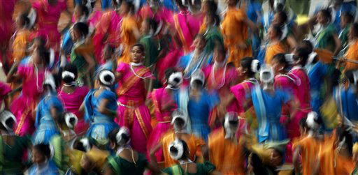 Indian girls wear traditional clothing as they dance for dignitaries during the main Republic Day parade in New Delhi, Thursday, Jan. 26, 2012. India is marking it&#39;s 62nd Republic Day with  parades across the country. &#40;AP Photo&#47;Kevin Frayer&#41; <span class=meta>(AP Photo&#47; Kevin Frayer)</span>