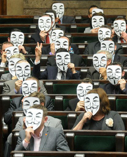 Lawmakers from the leftist Palikot&#39;s Movement cover their faces with masks as they protest against ACTA, or the Anti-Counterfeiting Trade Agreement, during a parliament session, in Warsaw, Poland, Thursday, Jan. 26, 2012, after the Polish government signed the agreement. Poland&#39;s plans to sign ACTA sparked attacks on Polish government websites and street protests in several Polish cities this week. &#40;AP Photo&#47;Alik Keplicz&#41; <span class=meta>(AP Photo&#47; ALIK KEPLICZ)</span>