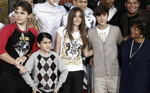 From left, Prince Jackson, Blanket Jackson, Paris Jackson, Justin Bieber, and Katherine Jackson pose together after the hand and footprint ceremony honoring musician Michael Jackson in front of Grauman&#39;s Chinese Theatre in Los Angeles, Thursday, Jan. 26, 2012. The ceremony was held to celebrate the &#34;Michael Jackson The Immortal World Tour&#34; by Cirque du Soleil.  &#40;AP Photo&#47;Matt Sayles&#41; <span class=meta>(AP Photo&#47; Matt Sayles)</span>