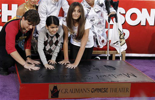 Paris, right, Prince, left, and Blanket Jackson put their hands in cement during the hand and footprint ceremony honoring their father, musician Michael Jackson, in front of Grauman&#39;s Chinese Theatre in Los Angeles, Thursday, Jan. 26, 2012. The ceremony was held to celebrate the &#34;Michael Jackson The Immortal World Tour&#34; by Cirque du Soleil.  &#40;AP Photo&#47;Matt Sayles&#41; <span class=meta>(AP Photo&#47; Matt Sayles)</span>