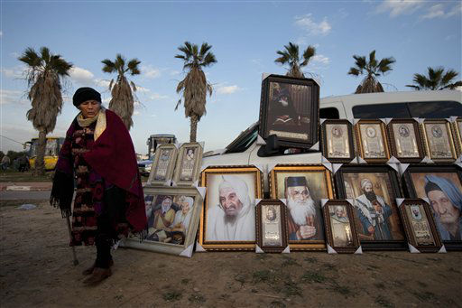 "<div class=""meta ""><span class=""caption-text "">A Jewish women stands next pictures of rabbis for sale near the tomb of the Baba Sali, Rabbi Yisrael Abuhatzeira, during the annual pilgrimage to his grave on the 28th anniversary of his death, in the southern Israeli town of Netivot, Thursday, Jan. 26, 2012. Thousands of Jews mostly from Moroccan origin came to pray over the respected Kabbalist rabbi known as a miracle maker by religious Jews.(AP Photo/Oded Balilty) (AP Photo/ Oded Balilty)</span></div>"