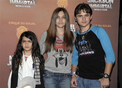From left to right, Blanket Jackson, Paris Jackson, and Prince Michael Jackson arrive at the opening night of the Michael Jackson The Immortal World Tour in Los Angeles on Friday, Jan. 27, 2012. &#40;AP Photo&#47;Dan Steinberg&#41; <span class=meta>(AP Photo&#47; Dan Steinberg)</span>