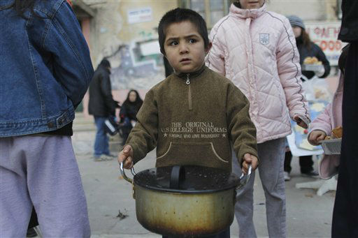 "<div class=""meta image-caption""><div class=""origin-logo origin-image ""><span></span></div><span class=""caption-text"">A child carries food distributed by a Greek humanitarian group in central Athens on Monday, Jan. 30, 2012. European leaders in Brussels Monday will seek ways to boost growth and create badly needed jobs amid a financial crisis sparked by Greece's debt woes. Greece and its bondholders have come closer to a deal to significantly reduce the country's debt and pave the way for it to receive a much-needed euro130 billion ($170 billion) bailout. (AP Photo/Petros Giannakouris) (AP Photo/ Petros Giannakouris)</span></div>"