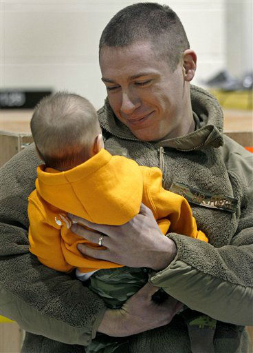 "<div class=""meta ""><span class=""caption-text "">Airman Daniel Fournier, of Mansfield, Conn and the 103rd Security Forces Squadron, admires his three-month-old son Hunter, who was born during deployment, at the Bradley Air National Guard base in East Granby, Conn., Monday Jan. 30, 2012.  Twenty-five Connecticut National Guard airmen, who  were responsible for security at Bagram Airbase, returned home after their July 2011. (AP Photo/Charles Krupa) (AP Photo/ Charles Krupa)</span></div>"