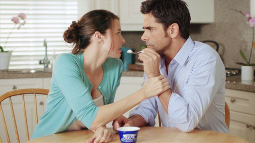 This advertisement provided by Dannon Co,. shows a scene from the Dannon Oikos Greek Yogurt Super Bowl commercial, starring Jessica Blackmore and John Stamos. The Dannon Oikos advertisement will run during the third quarter of Super Bowl XLVI, Sunday, Feb 5, 2012. About 20 of the roughly 36 Super Bowl advertisers put their TV commercials online in the days leading up to Sunday&#39;s broadcast. That&#39;s a big break with tradition and up from last year when only a handful of companies released their ads before the game. Stamos&#39; Dannon ad is one of the ads that have been pre-released. &#40;AP Photo&#47;Dannon Co.&#41; <span class=meta>(AP Photo&#47; Anonymous)</span>