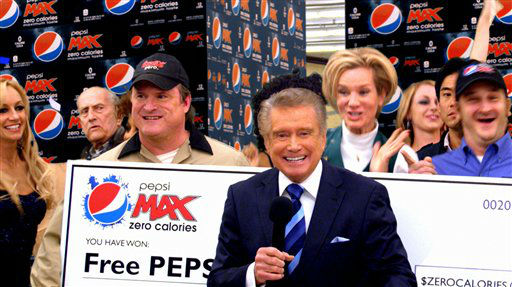 "<div class=""meta image-caption""><div class=""origin-logo origin-image ""><span></span></div><span class=""caption-text"">Regis Philbin is featured in the new Pepsi MAX Super Bowl commercial ""Check-Out,"" surprising a startled competitor deliveryman who wins ""Pepsi MAX for Life.""</span></div>"