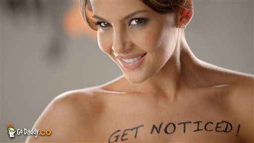This advertisement provided by GoDaddy.com, shows a scene from the ad &#34;Body Paint,&#34; featuring Colombian model Natalia Velez. The ad will air during Super Bowl XLVI, Sunday, Feb. 5, 2012. &#40;AP Photo&#47;GoDaddy.com&#41; <span class=meta>(AP Photo&#47; Anonymous)</span>