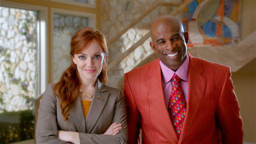 This advertisement provided by Century 21, shows a scene from the ad &#34;Smarter, Bolder, Faster,&#34; with a Century 21 saleswoman and NFL analyst Deion Sanders. The ad will air during Super Bowl XLVI, Sunday, Feb. 5, 2012. &#40;AP Photo&#47;Century 21&#41; <span class=meta>(AP Photo&#47; Anonymous)</span>